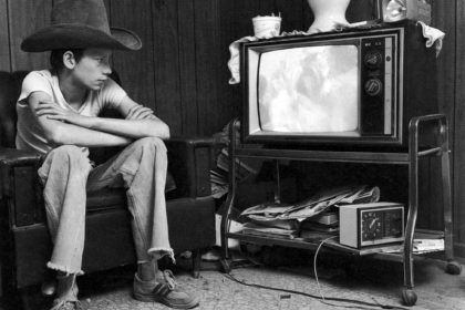 Photos from Portraits and Dreams: Johnny watching television, from Johnny's Story