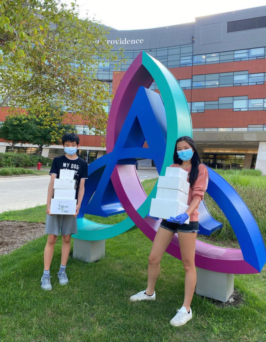 2 students collect unused food