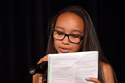 Student reading a poem